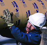 Man carrying sonotube